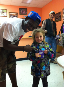 Joshua Johnson and young fan